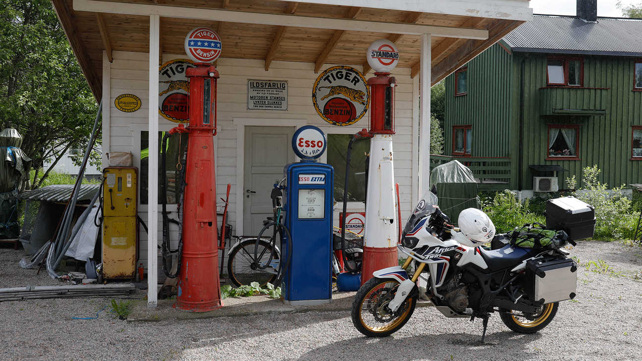 Bike parked up at a fuel station off the beaten track.