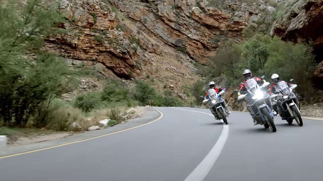 Front facing Africa Twin bikes riding through South Africa.