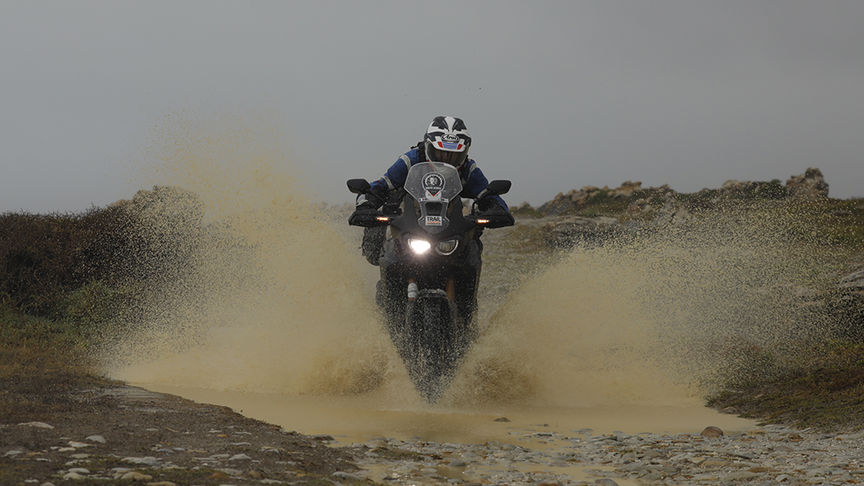 Motorbike rider riding through the tough terrains of South Africa.